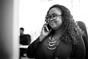 Customer Success consultant sitting at desk.